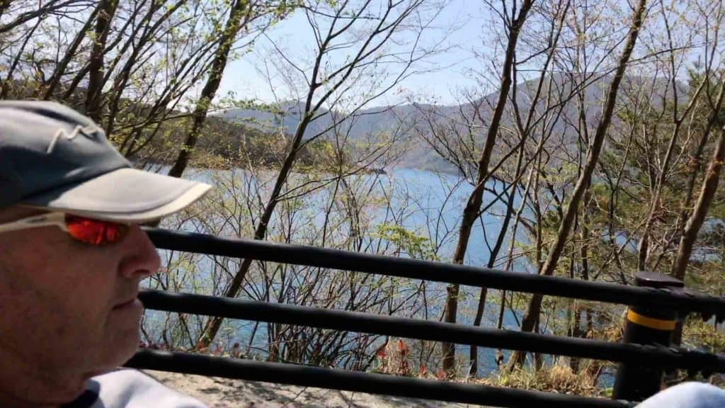 recumbent trike rider and view of lake